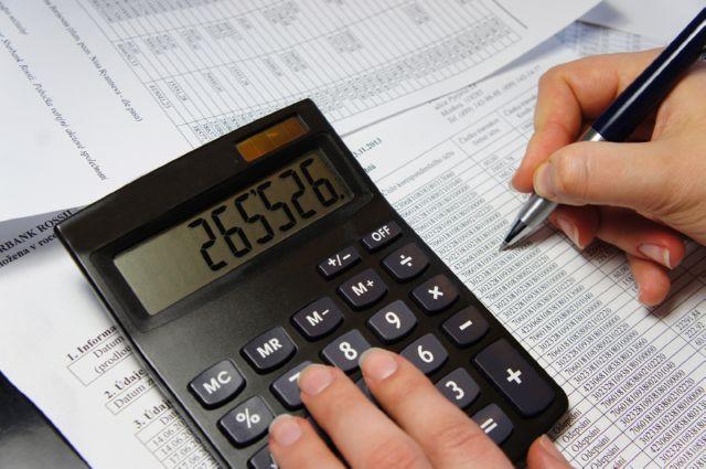 Как определить ставку земельного налога